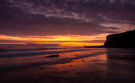 A beautiful sunrise at Tynemouth's King Edward's Bay, as the sky explodes with color