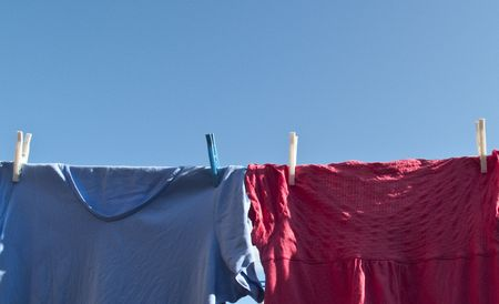 Washing hanging on a line with a lovely blue sky photo