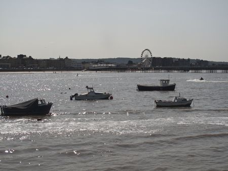 weston super mare: Some boats moored in weston super mare harbour with the westonsightseeing wheel in the distance