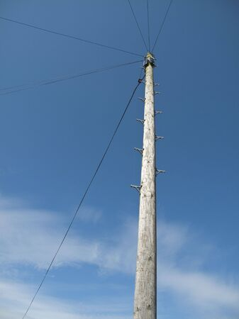 telegraph: A british telegraph pole with a blue sky background Stock Photo