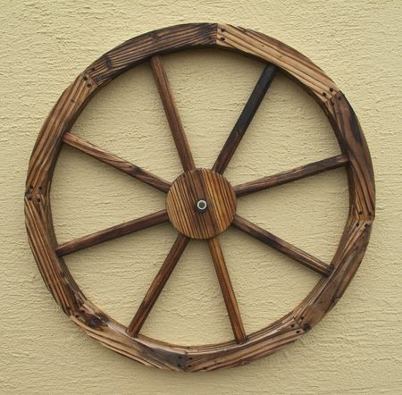 a decorative wagon wheel isolated on a wall
