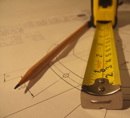an extended tape measure with a pencil and cad drawing