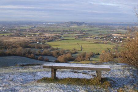 A frosty bench at the top of crickley hill in Gloucestershire photo