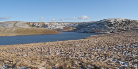 panoramic view of the dams at Elan Valley, with snow capped mountains