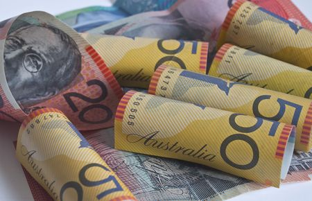 australian dollars: some australian dollars rolled up