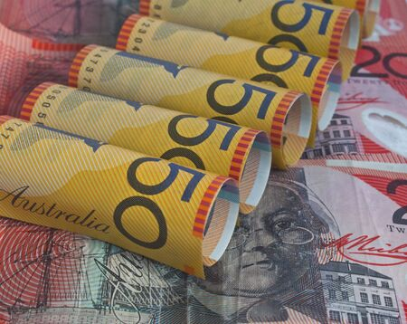 some austrailian dollars with the fifty dollar bill rolled up  Stock Photo