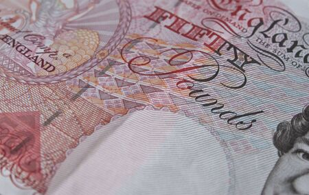 a soft focus close up shot of a fifty pound note