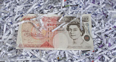a fifty pound note on top of some shredded paper Stock Photo