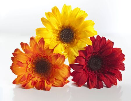 red, orange, yellow artificial flowers stacked up
