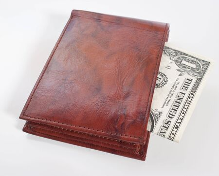 a brown leather wallet with a one dollar bill inside, focus on front of wallet