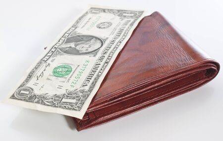 a brown leather wallet with a one dollar bill on top, shallow depth of focus on front of wallet