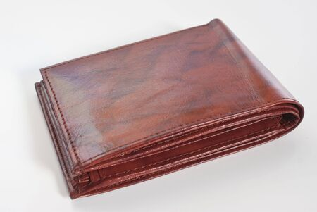 an empty brown leather wallet isolated on white background