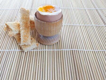 a boiled egg with some toast to dip into the lovely fresh yolk photo