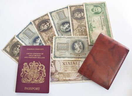 lots of foreign currency, a passport and a wallet - ready to travel photo