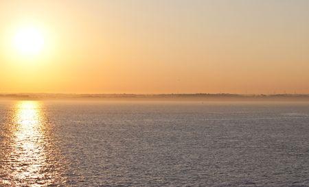 a bright orange sunset over the sea Stock Photo