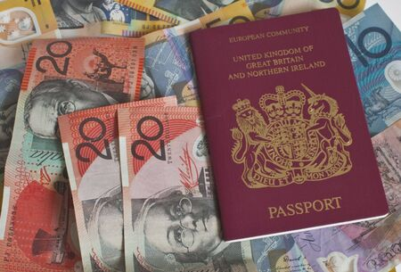 a passport on top of some colurful euro notes Stock Photo