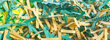 some green and yellow shredded paper strips