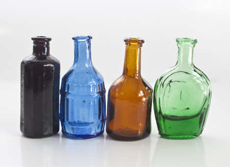 some different coloured old style medicine bottles Stock Photo