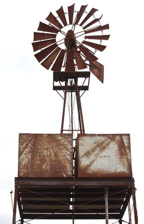 an old water windmill, rusted with age Stock Photo