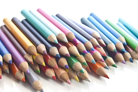 a stack of different coloured pencils