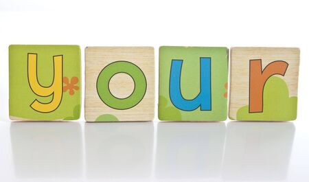 wooden tiles with the letters Y O U R ( YOUR ) Stock Photo