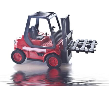 a red toy fork lift truck with a reflection Stock Photo