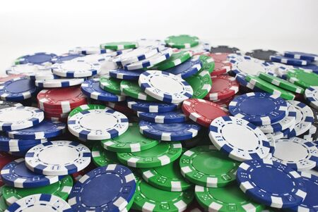 lots of poker chips scattered as a background texture Stock Photo - 7866454