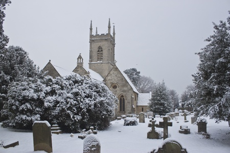 snow fallen around the church yard at upton st lenoards