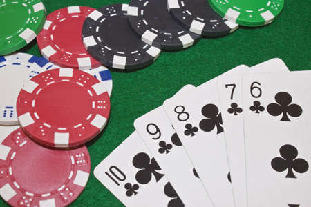 running club flush poker hand with chips