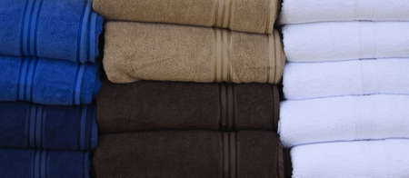 some towels stacked up in various colours Stock Photo - 10733113