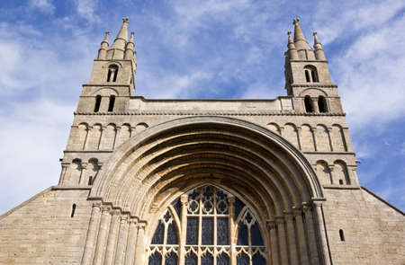 the main front entrance to tewkesbury abbey