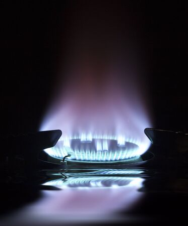 blue flame on gas hob with reflection Stock Photo - 11328688