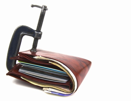 wallet full of money, but restricted with clamp Stock Photo