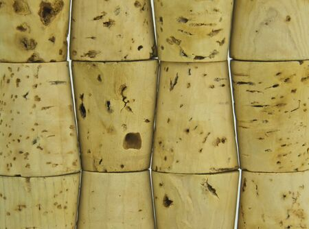 some used wine corks stacked on top of each other