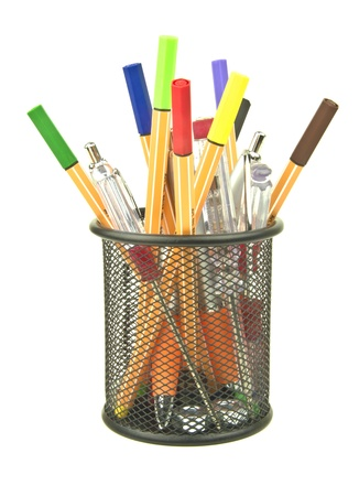 desk tidy black pot containing pens and stationary Stock Photo - 15011751