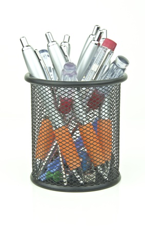 junk and pens in a desk tidy pot Stock Photo - 15011755