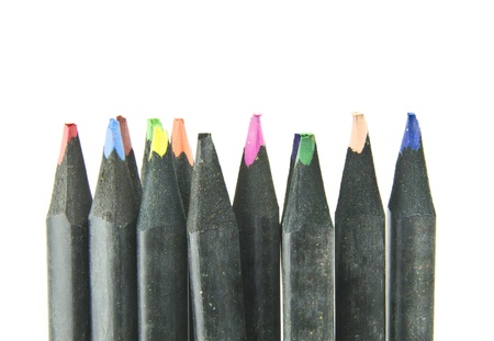 black colouring pencils lined up against white background