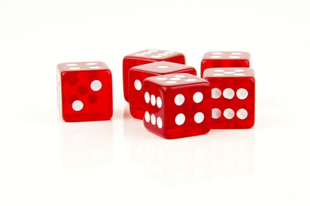 some red dice scattered on white background