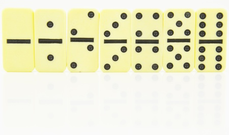 the doubles of dominoes stood in order with slight reflection Stock Photo - 16048228