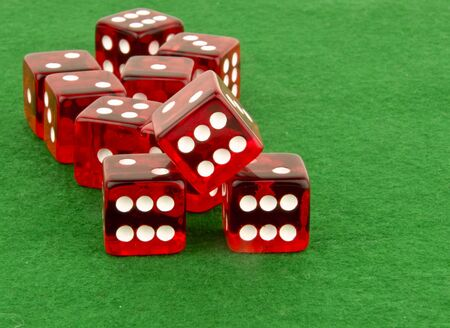 multiple red dice on green cloth