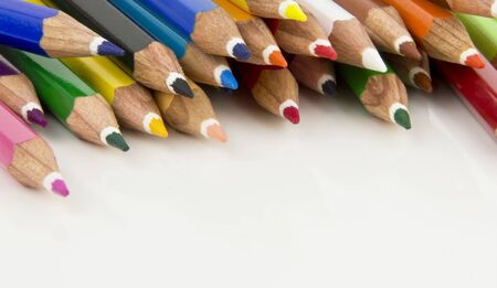some coloured pencil tips top of a page Stock Photo