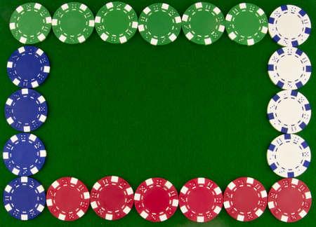 border of poker chips on green beize