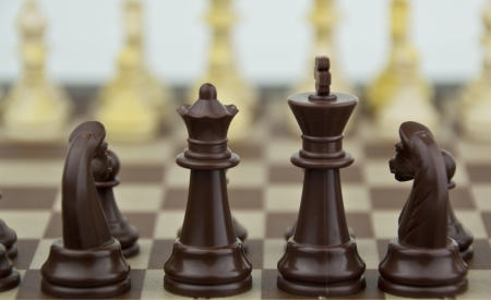 some chess pieces, soft focus in background Stock Photo - 16729757
