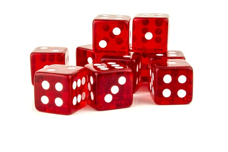 some red dice scattered with different numbers