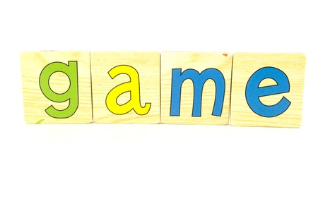 game spelt out with wooden tiles Stock Photo