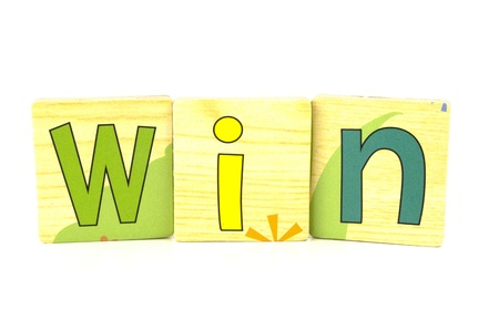 win spelt out with wooden tiles