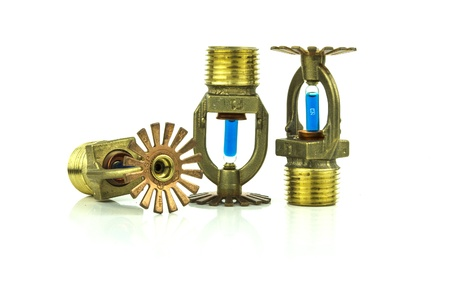 some brass fire sprinklers with copy space Stock Photo