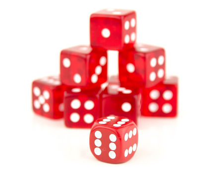 reducing: some stacked red dice behind a 666, Cheating or reducing the odds