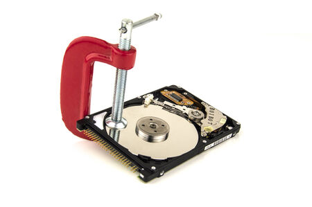 security concept, hard drive in a clamp