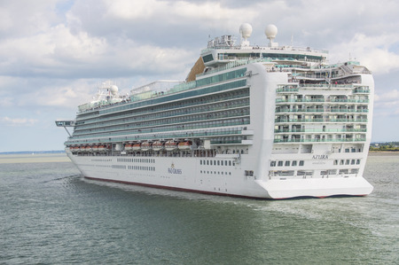 SOUTHAMPTON - JULY 13, 2014: Azura just leaving Southampton docks, UK on July 13, 2014. Azura is the newest (built 2010) and largest ship of P&O Cruises, which is the oldest cruise operator worldwide. Editorial